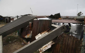 Two men try to rebuild their shack after #CapeStorm damages