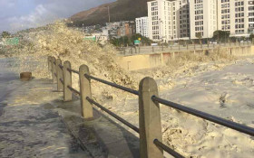 [Video] It's a guy. In a wetsuit. On a bicycle! Only in Cape Town #CapeStorm
