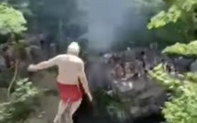 [WATCH] Adrenaline junkie 73-year-old grandpa jumps off cliff into water