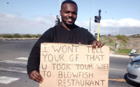 Funny placards inspire samaritan to help unemployed Dunoon dad save for house