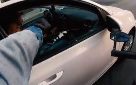 [WATCH] Motorcyclist films himself driving around giving fist pumps to passersby