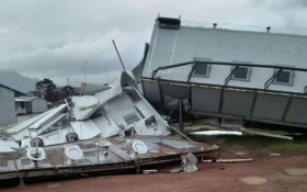 Strong winds flatten and overturn temp classrooms at Strand school