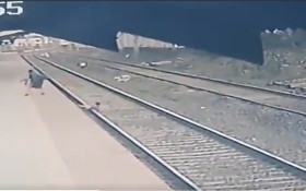[WATCH] Man rescuing child who fell onto railway track goes viral