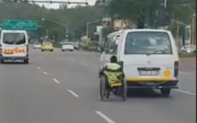 Video of man 'skitching' in wheelchair goes viral!