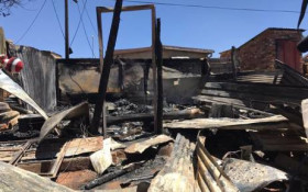 Homes destroyed by fire in  #ImizamoYethu
