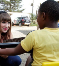 Kelly gives young children free guitar lessons