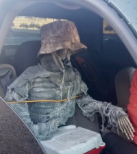 Dead wrong!  Driver bust for using carpool lane with fake skeleton as passenger