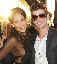 Creepy or cute? Robin Thicke really wants Paula back!