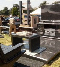 Customised tombstones celebrate the personality of the deceased