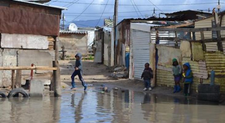 City officials handing out flood kits at informal settlements