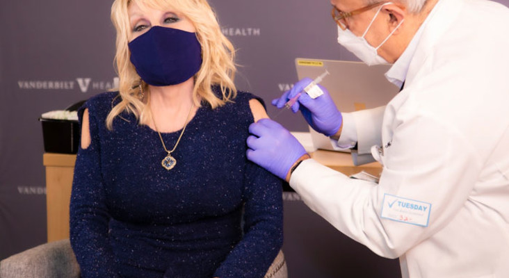 Dolly Parton gets taste of own medicine, sings about vaccine while getting jab