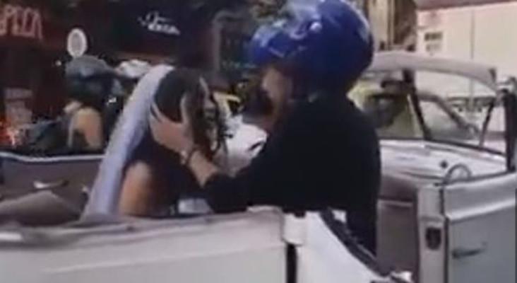[WATCH] Biker pulls up beside ex's wedding car, begs her not to get married