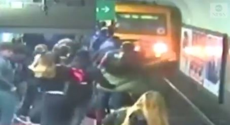[WATCH] Commuters on station stop train from hitting passenger