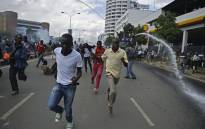 FILE: Protestors run from water canons after Kenya's opposition supporters demonstrated in Nairobi, on 16 May, 2016. Picture: AFP.