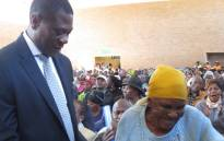 Maria Sibanda (87) pictured with Gauteng Human Settlements MEC Paul Mashatile after receiving the title deed to her home on 1 June 2017. Picture: Supplied