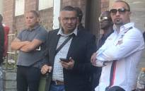 Nafiz Modack and Colin Booysen outside the Cape Town central police station after court proceedings. Picture: Shamiela Fisher/EWN