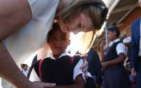 Education MEC Debbie Schafer consoled a grade one pupil at Levana Primary School in Lavender Hill, on her first day of school. Picture: Bertram Malgas