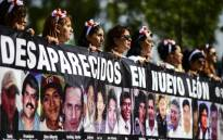 Activists, relatives and mothers of missing people, march to demand the Mexican government answers about their loved ones whereabouts, as part of the commemoration of Mothers' Day in Mexico City on 10 May, 2018. Picture: AFP.