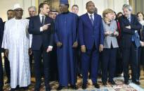 Mali's President Ibrahim Boubacar Keita, France's President Emmanuel Macron, Chad's President Idriss Deby, Niger's President Mahamadou Issoufou, German Chancellor Angela Merkel, Italy's Prime Minister Paolo Gentiloni and France's Defence Minister Florence Parly at a summit of the G5 anti-terror coalition on 13 December 2017. Picture: AFP.