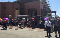 People seen outside Unisa's Sunnyside campus where protests took place, on 15 January 2018. Picture: Ihsaan Haffajee/EWN.