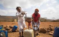 Two women pump water from a borehole in Emanyiseni, Kwa-Zulu Natal. Picture: Thomas Holder/EWN