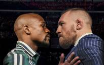 FILE: Undefeated American boxing champion Floyd Mayweather (L) and mixed martial arts champion Conor McGregor. Picture: Themaclife.com.