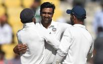 Indian cricketer Ravichandran Ashwin (C) celebrates with captain Virat Kohli (L) after India won the second Test cricket match against Sri Lanka at the Vidarbha Cricket Association Stadium in Nagpur on 27 November 2017. Picture: AFP.