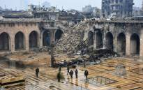 A general view shows Syrian pro-government forces walking in the ancient Umayyad mosque in the old city of Aleppo on 13 December 2016. Picture: AFP