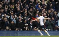 FILE: Tottenham Hotspur's English striker Harry Kane (R) celebrates with the crowd . Picture: AFP