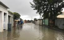 Cape Town heavy rain left the streets of Hanover Park flooded. Some residents are trapped in their homes. Picture: Monique Mortlock/EWN.
