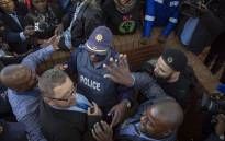 BLF confront AfriForum CEO Kallie Kriel outside the Randburg magistrates court on 12 July 2018 following Duduzane Zuma's court appearance. Picture: Thomas Holder/EWN