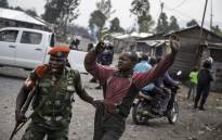 A man is arrested by a member of the military police after people attempted to block the road with rocks, in the neighbourhood of Majengo in Goma, eastern Democratic Republic of the Congo. Picture: AFP.