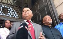 FILE: Former finance minister Pravin Gordhan and former deputy finance minister Mcebisi Jonas speaks outside Treasury after being axed in a Cabinet reshuffle. Picture: Barry Bateman/EWN.