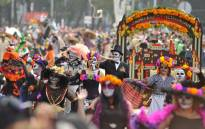 People take part in the Day of the Dead parade in Mexico City on 28 October 2017. Picture: AFP.