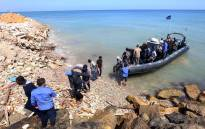 FILE: Migrants from Africa arrive on shore after being rescued by Libyan coast guards rescued at sea, off the coastal town of Tajoura, 15 kilometres east of the capital Tripoli, on 23 May 2017. Picture: AFP
