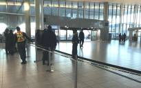 Officials pictured on scene at the Cape Town International Airport where two people were wounded during a shooting, on 18 October 2017. Picture: Lauren Isaacs/EWN