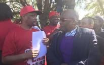 Health Minister Aaron Motsoaledi receiving a memorandum of demands from Nehawu General Secretary Zola Saphetha. Picture: Masechaba Sefularo/EWN.