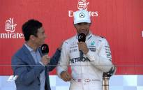 Lewis Hamilton (R) chats to a reporter after winning a Japanese Grand Prix on Sunday, 8 October 2017. Picture: @F1