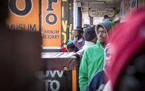 FILE: Beneficiaries queue outside a supermarket to collect their Sassa grants. Picture: Thomas Holder/EWN
