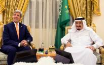 FILE: Saudi King Salman bin Abdulaziz (R) meeting with former US Secretary of State John Kerry in Hafar. Picture: AFP.
