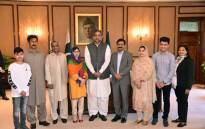 Pakistani Prime Minister Shahid Khaqan Abbasi (C) posing for a photograph with Pakistani activist and Nobel Peace Prize laureate Malala Yousafzai. Picture: AFP