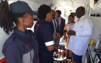 Gauteng premier David Makhura inspects one of the 82 new ambulances handed over to the provincial health department. Picture: Vumani Mkhize/EWN.