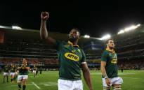 Springbok flank Siya Kolisi, greets fans as the team does a victory lap at Newlands. Photo: Bertram Malgas