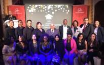 Western Cape Minister of Social Development Albert Fritz, centre back, is seen among the 16 people who had received bursaries from the Grandwest CSI Bursary Fund. Picture: www.westerncape.gov.za.