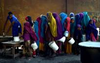 A severe drought is threatening famine in Somalia, where the UN estimates 5.5 million people at risk. Young girls line up at a feeding centre in Mogadishu. Picture: United Nations Photo