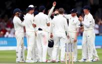 England's spinner Moeen Ali holding the ball as he and teammates celebrate first Test victory against South Africa at Lord's. Picture: Twitter/@englandcricket.