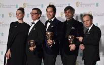 FILE: Canadian set decorator Jeff Melvin, Production designer Paul Austerberry and set decorator Shane Vieau pose with the award for Production Design for work on the film 'The Shape Of Water' with citation readers Swedish actress Rebecca Ferguson (L) and British actor Toby Jones (R) at the Bafta British Academy Film Awards at the Royal Albert Hall in London on 18 February 2018. Picture: AFP.