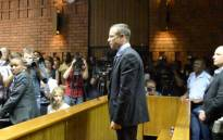 FILE: Oscar Pistorius stands in the dock as he waits to hear the outcome of his bail application. Picture: EWN.