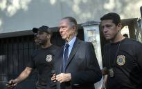 Brazil's Olympic Committee chief Carlos Nuzman is escorted from his home by federal police in Rio de Janeiro on 5 October 2017. Picture AFP.