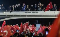 Turkish president Recep Tayyip Erdogan (C) delivers a speech to supporters in Istanbul, on April 16, 2017, after the results of a nationwide referendum that will determine Turkey's future. Picture: AFP.